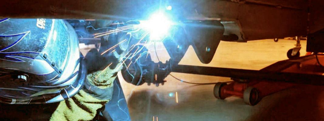 man-welding-caravan-chassis